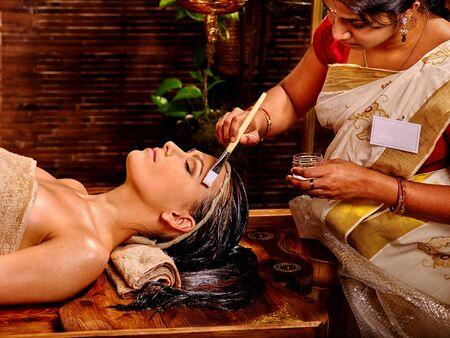natural face: Woman having facial mask at ayurveda spa. Stock Photo