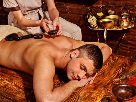 india woman: Man  having oil Ayurveda spa treatment.