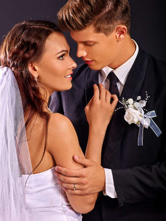 dress suit: Bride and groom wearing wedding dress and suit Stock Photo