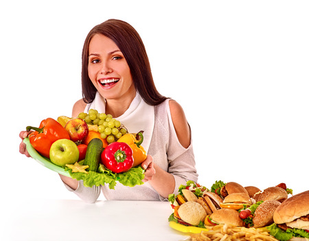 beefburger: Woman choosing between healthy and unhealthy eating.