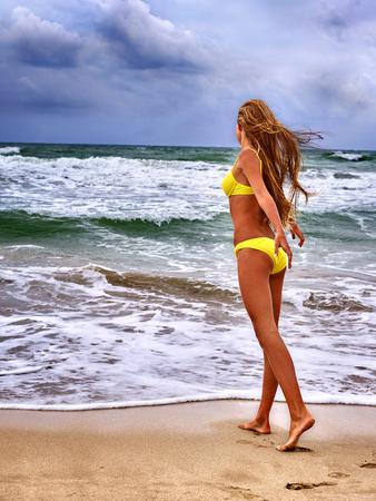sea wave: Summer girl sea.  Woman in  swimsuit on beach near ocean with waves.