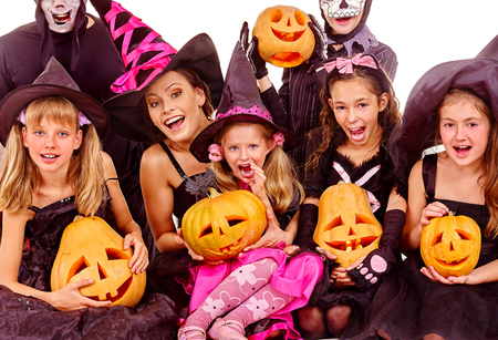 Halloween party with group children holding carving pumpkin Stock Photo