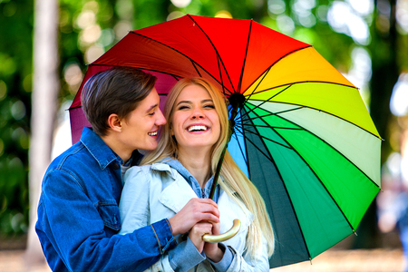 couple nature: Happy young couple embracing under umbrella in autumn day. Love and couple relationships concept and idea.