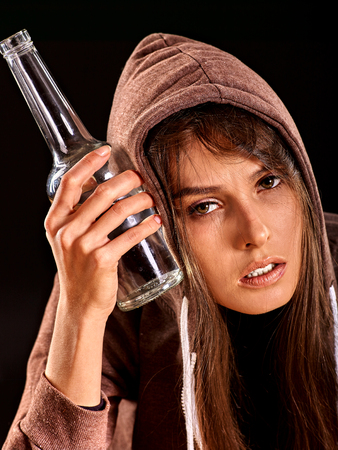 drunk: Drunk girl holding bottle of alcohol. Soccial issue alcoholism.