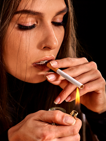 cigarette lighter: Young woman  smokes cigarette. Soccial issue smoking. Stock Photo