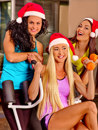 gym clothes: Girls holding dumbbells in sport gym. Sport Christmas concept