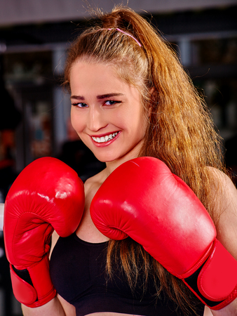 sports venue: Portrait of sport girl boxing wearing red gloves. Stock Photo