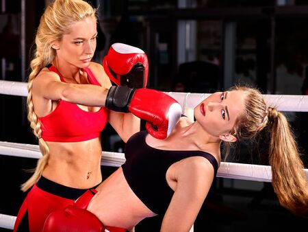 show ring: Two  women boxer wearing red  gloves to box in ring. Stock Photo