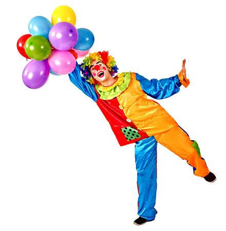 caritas pintadas: Feliz cumpleaños payaso sosteniendo un manojo de globos. Aislado.
