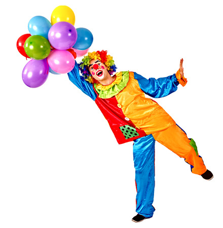 circus: Happy birthday clown holding a bunch of balloons.  Isolated.