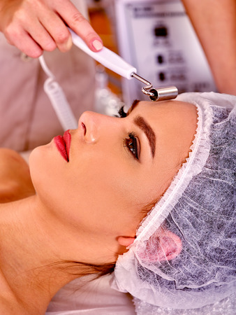 procedures: Procedure of hydradermie. Young woman receiving skincare in beauty salon.