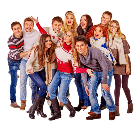Group of happy young people in warm winter clothes. Isolated.