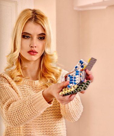 sick person: Young woman having pills and tablets.