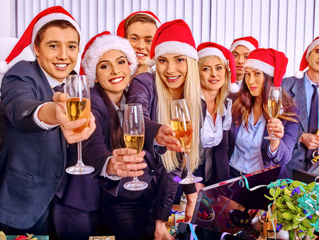 Happy business group people in santa hat at Xmas corporate party. Stock Photo