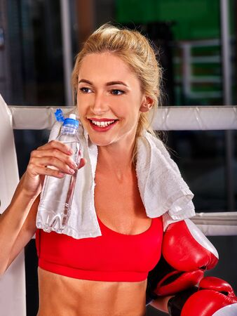 showgirl: Portrait of sport girl boxing wearing red gloves. Stock Photo