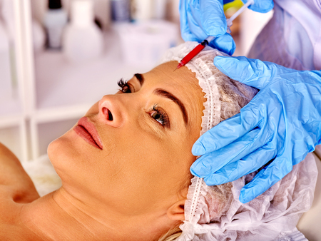 middleaged: Woman middle-aged in spa salon with beautician.  Stock Photo