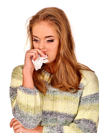 woman alone: Portrait of crying young nice girl with a handkerchief. The reasons may be different. Colds, allergies or depression. Isolated.