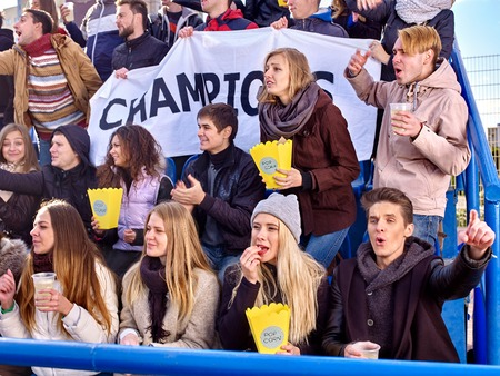 grandstand: Sport fans holding champion banner  and eating popcorn on tribunes. Group people.