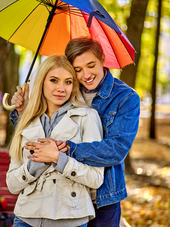 young happy couple: Loving couple embracing under umbrella . Love and couple relationships concept and idea.
