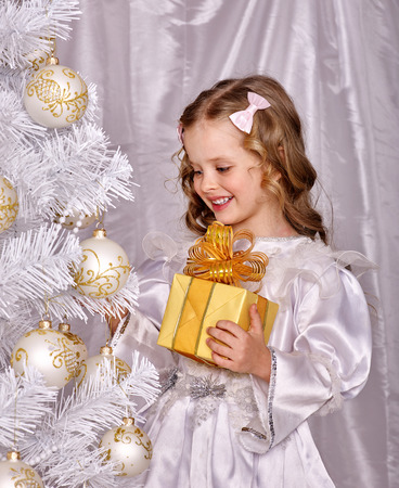 open box: Child holding gift box  decorate  Christmas tree. Isolated. Stock Photo