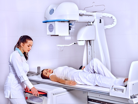 health care: Patient  in x-ray room looking at female doctor. Medicine. Stock Photo