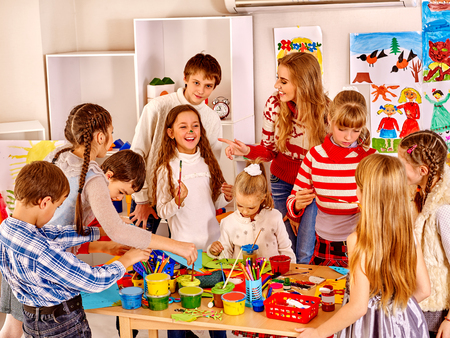 school classroom: Group happy children painting at art school. Education. Stock Photo