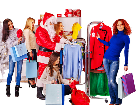 coathanger: Shopping women with Santa on Christmas sales do purchase.