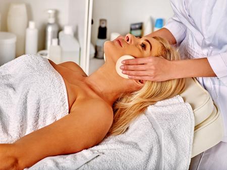 recieve: Woman middle-aged in spa salon recieve beauty procedure . Stock Photo