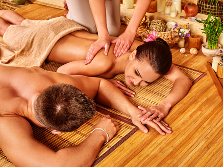 spa  thai massage: Young family  relaxing in bamboo spa.