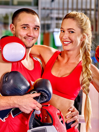 combative sport: Couple Man and  Woman in red Wearing Gloves Boxing in Ring.