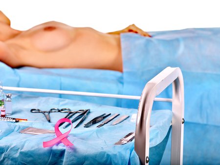 anatomy naked woman: Preparation to breast cancer surgery on isolated. Pink ribbon symbol. Concept.