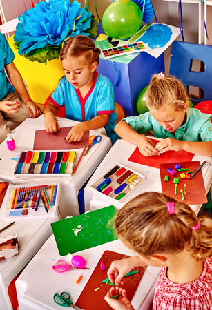 molded: Group kids molded of plasticine table in kindergarten . Top view.