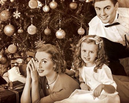 father: Family with children  , mother and father dressing Christmas tree. Black and white retro vintage. Stock Photo