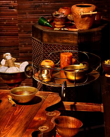 herbal massage ball: Luxury ayurvedic spa massage with candles still life. Stock Photo