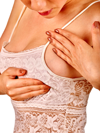 breast milk: Beautiful woman in lingerie touching examines her breasts. Stock Photo