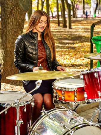 performers: Music street performers woman  on autumn outdoor. Stock Photo