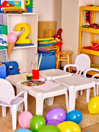 art and craft: Interior of game room in preschool  kindergarten. No people.