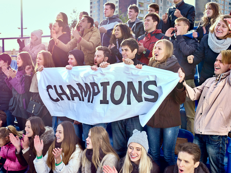 sports fans: Sport fans holding very big champions banner  and singing on tribunes. Group people.