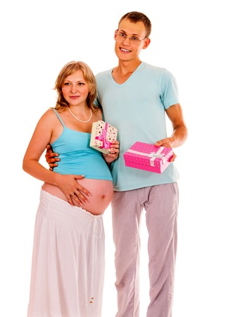 enceinte: Pregnant woman with husband and gift boxes on white background isolated. Stock Photo