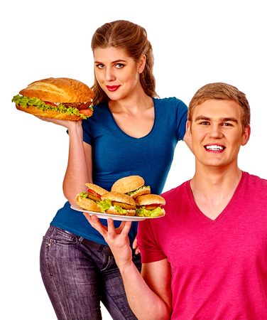 beefburger: Young couple man and woman holding a lot of hamburgers. Fastfood concept.  Isolated.