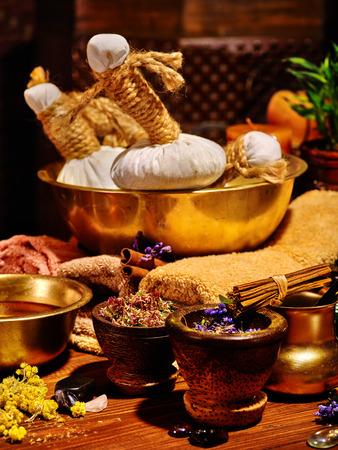 lastone: Luxury ayurvedic spa massage still life on wooden.