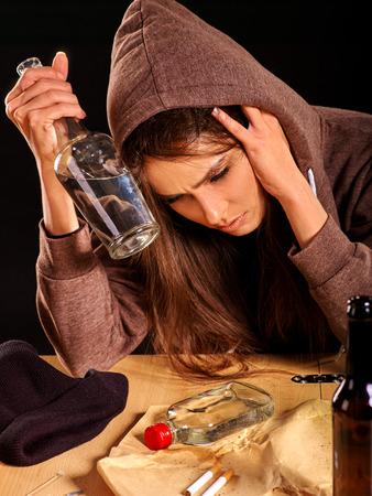 drunk girl: Drunk girl drinking bottle  alcohol. Soccial issue alcoholism.