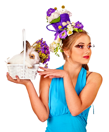 sexy glamour model: Fashion woman in easter style hairstyle holding bunny and flowers. Isolated. Stock Photo