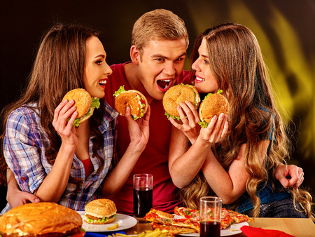 Small group people holding hamburgers and drinks cola . Stock Photo
