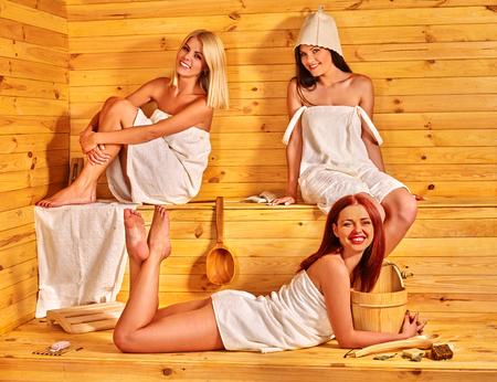 luxuriate: Happy group of girlfriends luxuriate in sauna.