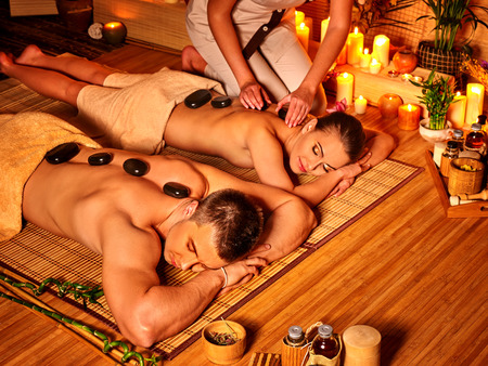 group of men: Man and woman luxuriate in bamboo spa.