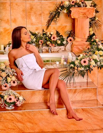 luxuriate: Woman luxuriate at flowers water spa.