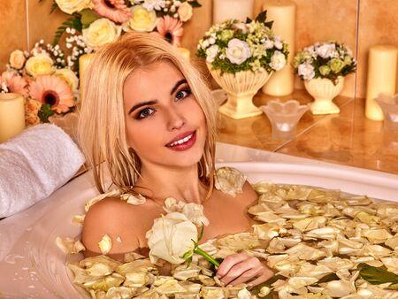 luxuriate: Smiling beautiful woman luxuriate at water spa.