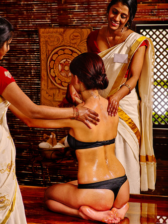 luxuriate: Young woman luxuriate  on oil Ayurveda spa treatment.