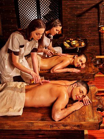 luxuriate: Couple  luxuriate  in Ayurveda spa treatment. Stock Photo